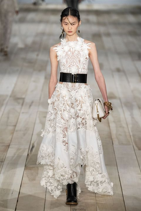 Fashion model, Clothing, Fashion, White, Dress, Shoulder, Haute couture, Runway, Waist, Fashion show,