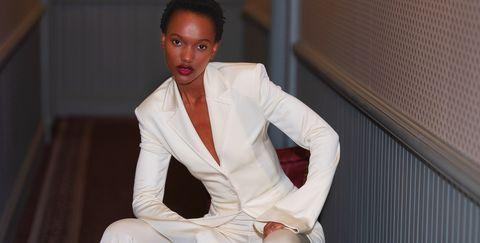 White, Fashion, Sitting, Room, Robe, Suit, Formal wear,
