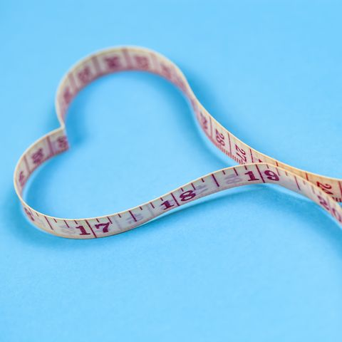 Measuring tape in heart shape. Healthy weight