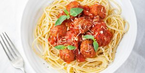 Meatballs in tomato sauce and fresh basil with spaghetti