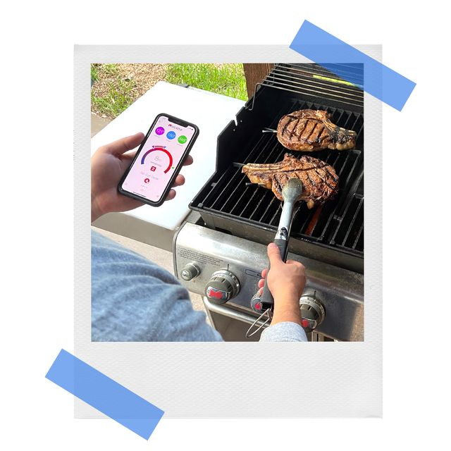 brandon using meater smart thermometer and app while grilling