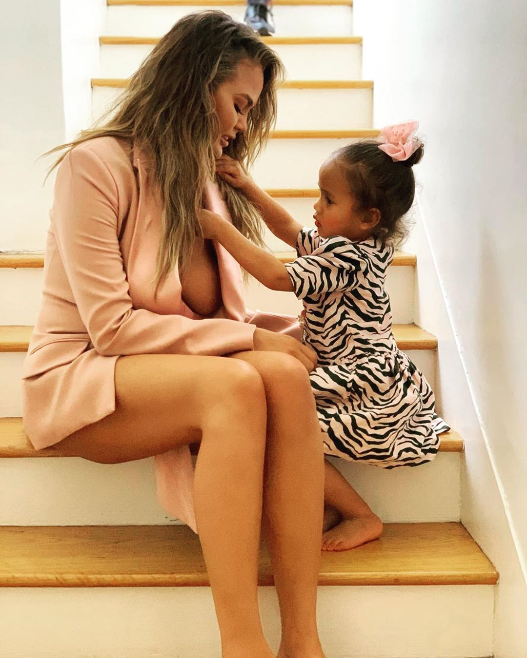 """Chrissy Teigen Claps Back at a Troll Who Tells Her to """"Cover Up"""" Around Her Daughter"""