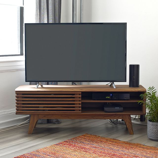 slatted media console with tv in living room