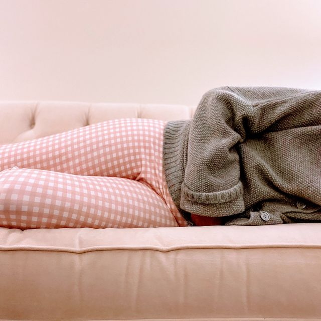 can medication affect your period a mid adult woman clutches stomach while lying down on couch