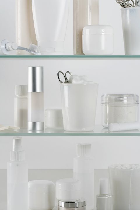 medicine cabinet full of skincare products