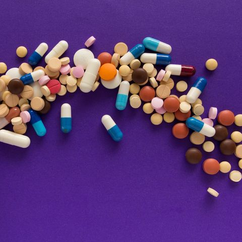 medicines with bottle on purple background