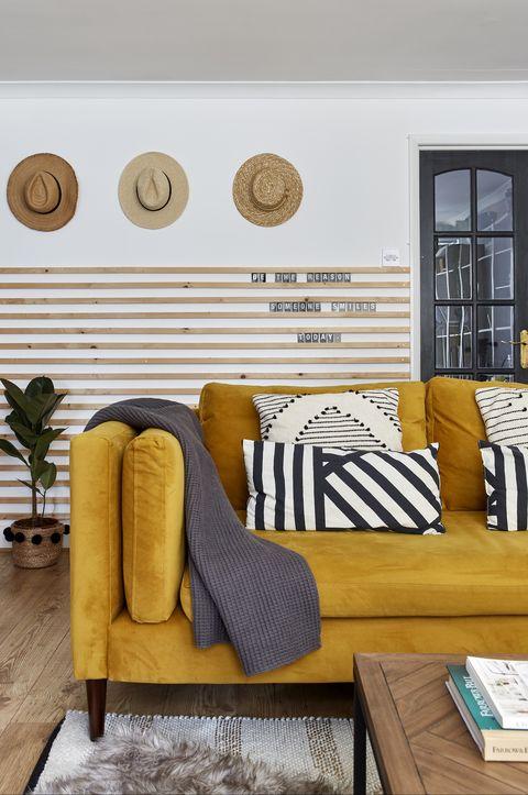 medina, grillodesigns   mustard yellow sofa in living room