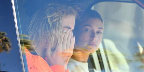 Justin Bieber appears to be crying as he and Hailey Baldwin head to his pastor's home in Beverly Hills