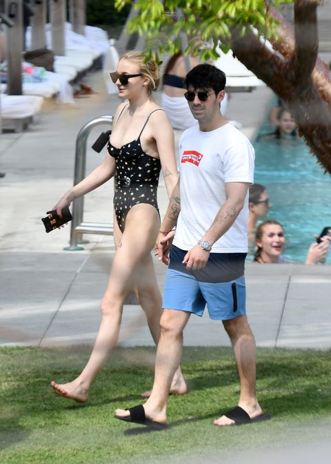 2548b734052a EXCLUSIVE: Actress Sophie Turner wears a black belted swimsuit as she was  with fiancé Joe