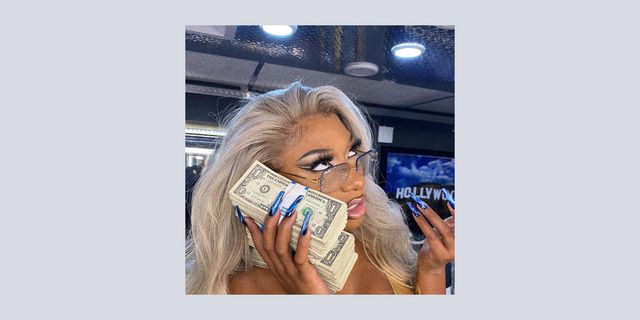 megan thee stallion cash savage instagram caption