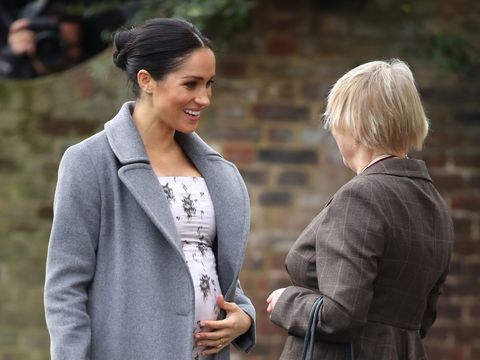 bd9f441ff20 The Duchess of Sussex wears winter florals by Brock Collection ...
