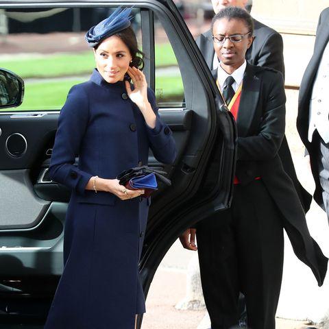 5bd5565994a Meghan Markle Wears a Navy Givenchy Dress to Princess Eugenie s Royal  Wedding