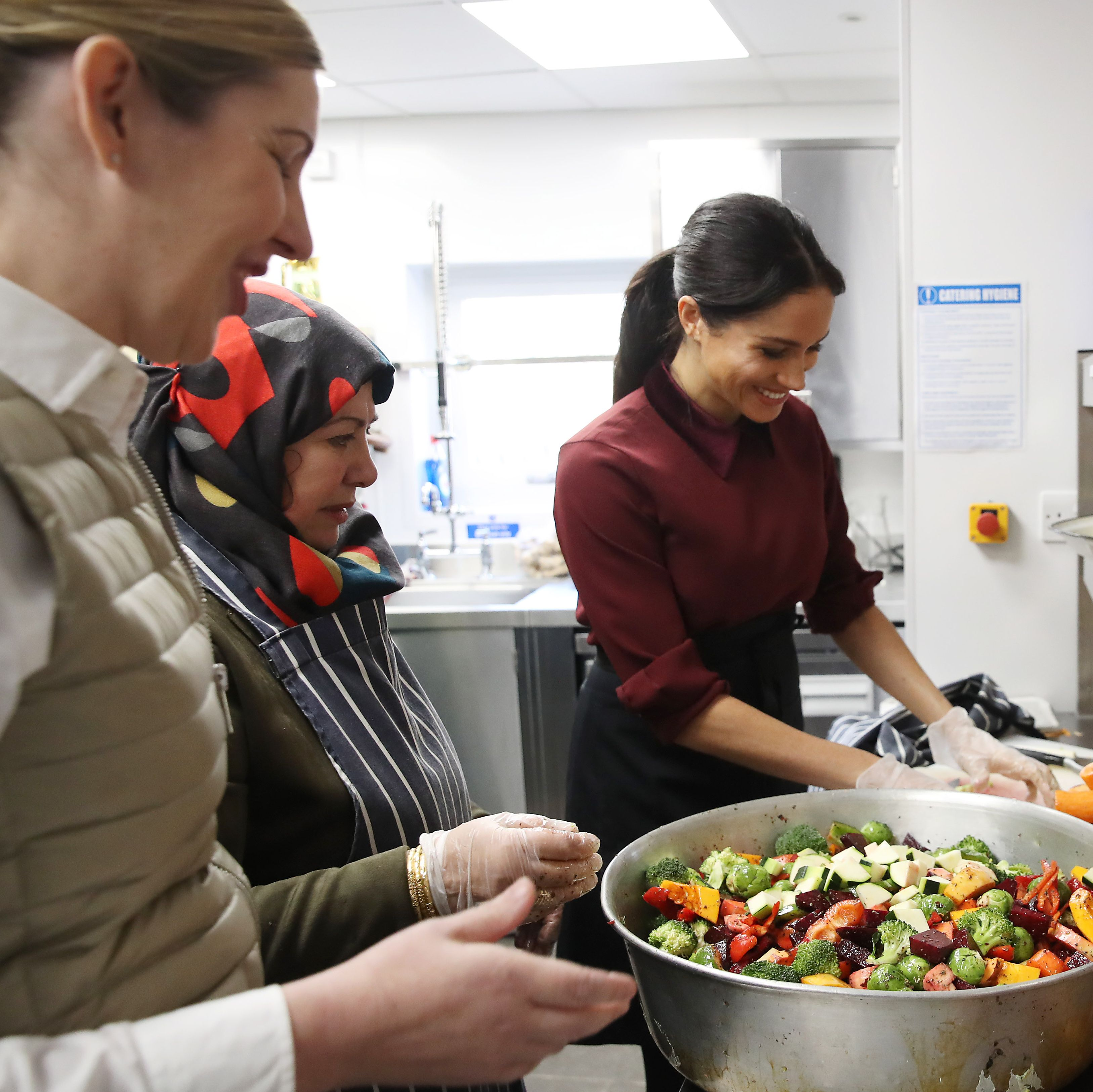 Meghan, Duchess of Sussex and chef Clare Smyth visit the Hubb Community Kitchen in London, England on November 21, 2018.
