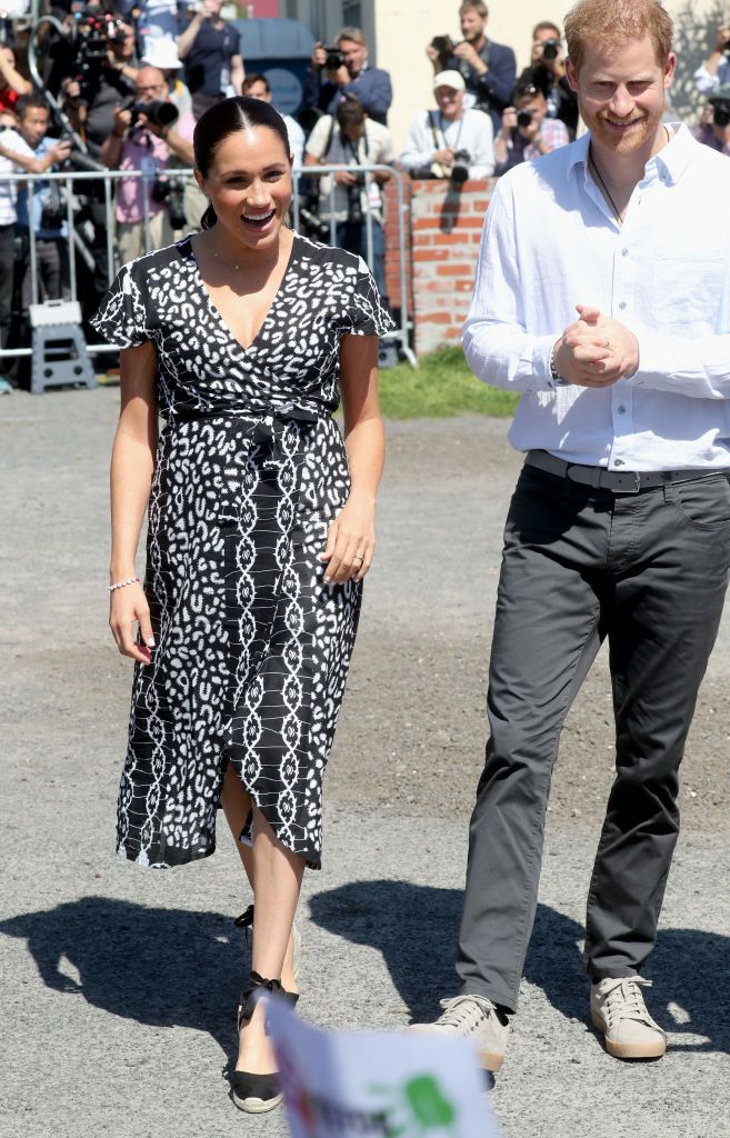Meghan Markle Looks Chic in a Black Wrap Dress With Prince Harry As They Start Their Royal Tour