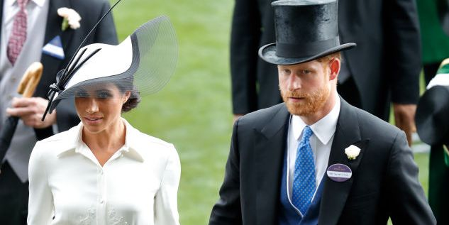"Prince Harry & Meghan Markle Discuss ""Saddening"" Royal Exit Process"
