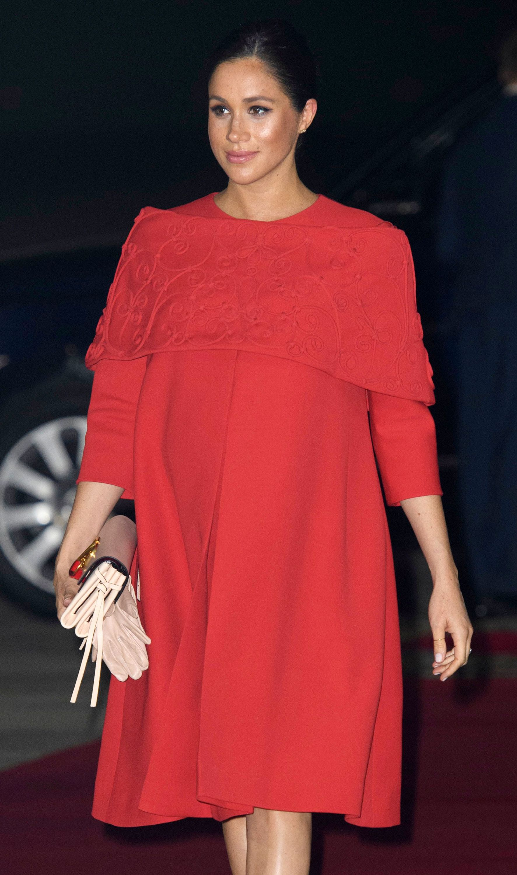 9ab9634c932 Meghan Markle Prince Harry Casablanca Airport Photos - Meghan Markle  Arrived in Morocco Wearing the Most Amazing Red Dress