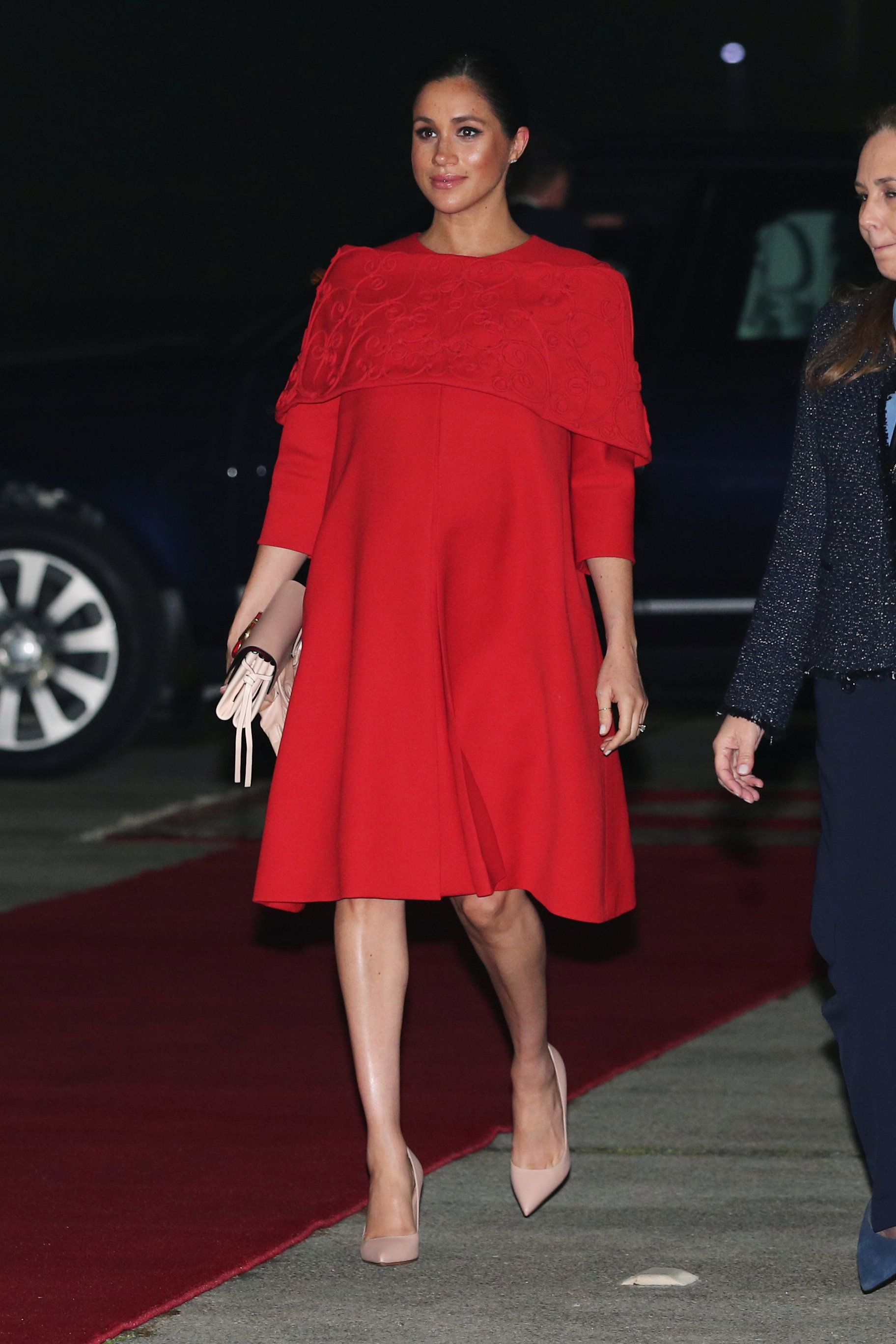 02320e8235d Meghan Markle Just Wore a Red Valentino Cape Dress For Her First Day in  Morocco