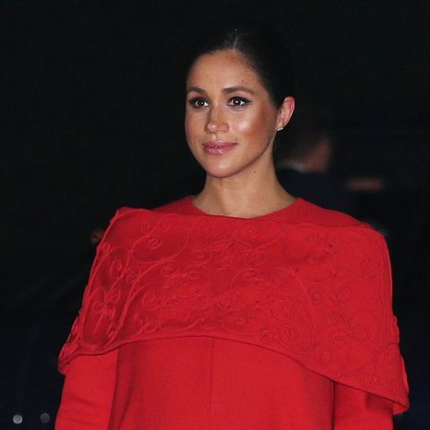 dd9bd792c31 Meghan Markle Just Arrived in Morocco Wearing a Striking Red Valentino Cape  Dress