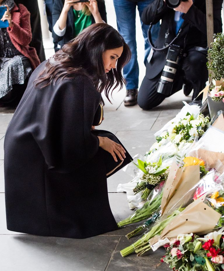 Meghan lays a bouquet outside New Zealand House.