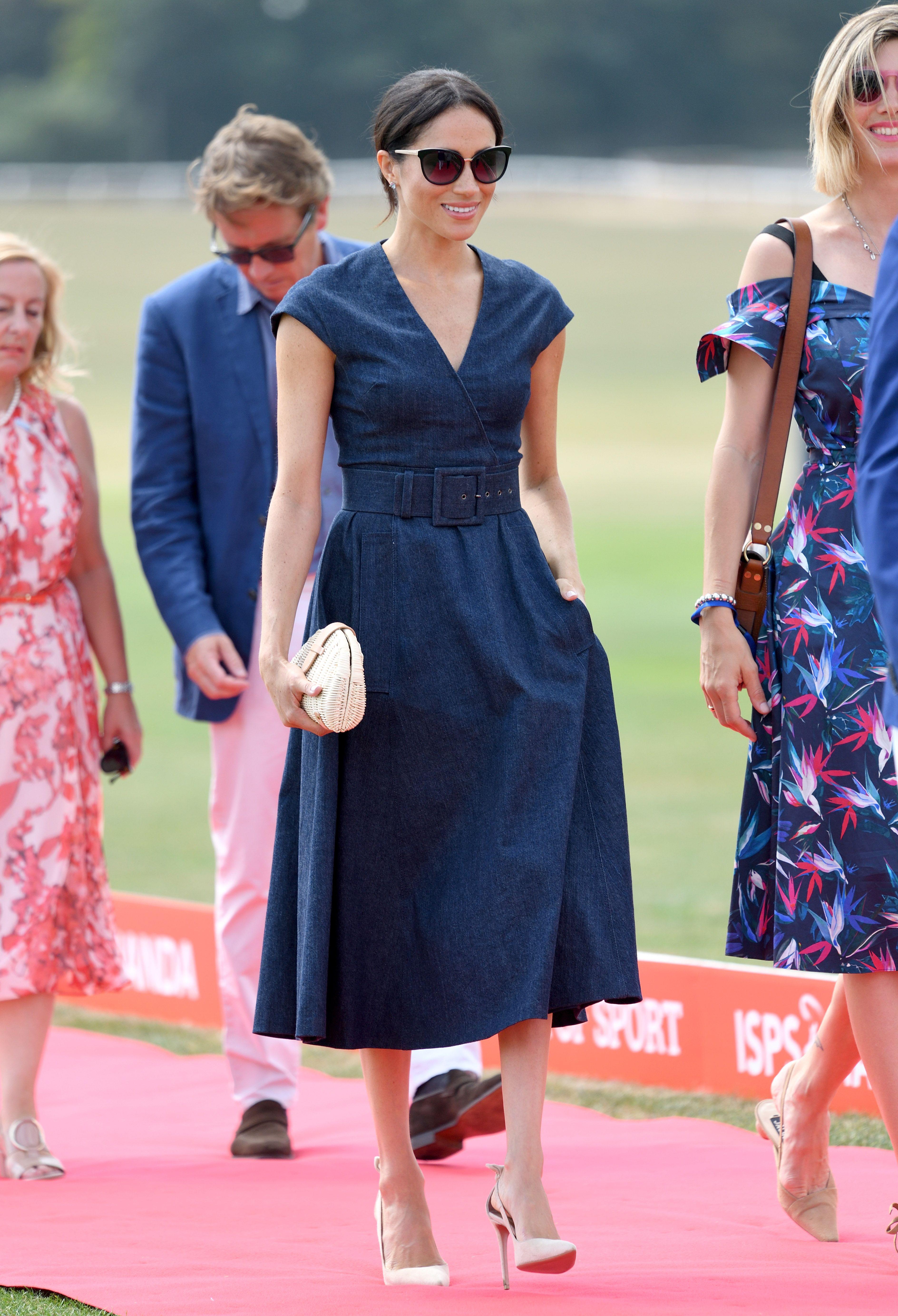 ff369e3c99 Meghan Markle in Denim Carolina Herrera Dress With Prince Harry at  Sentebale Polo 2018