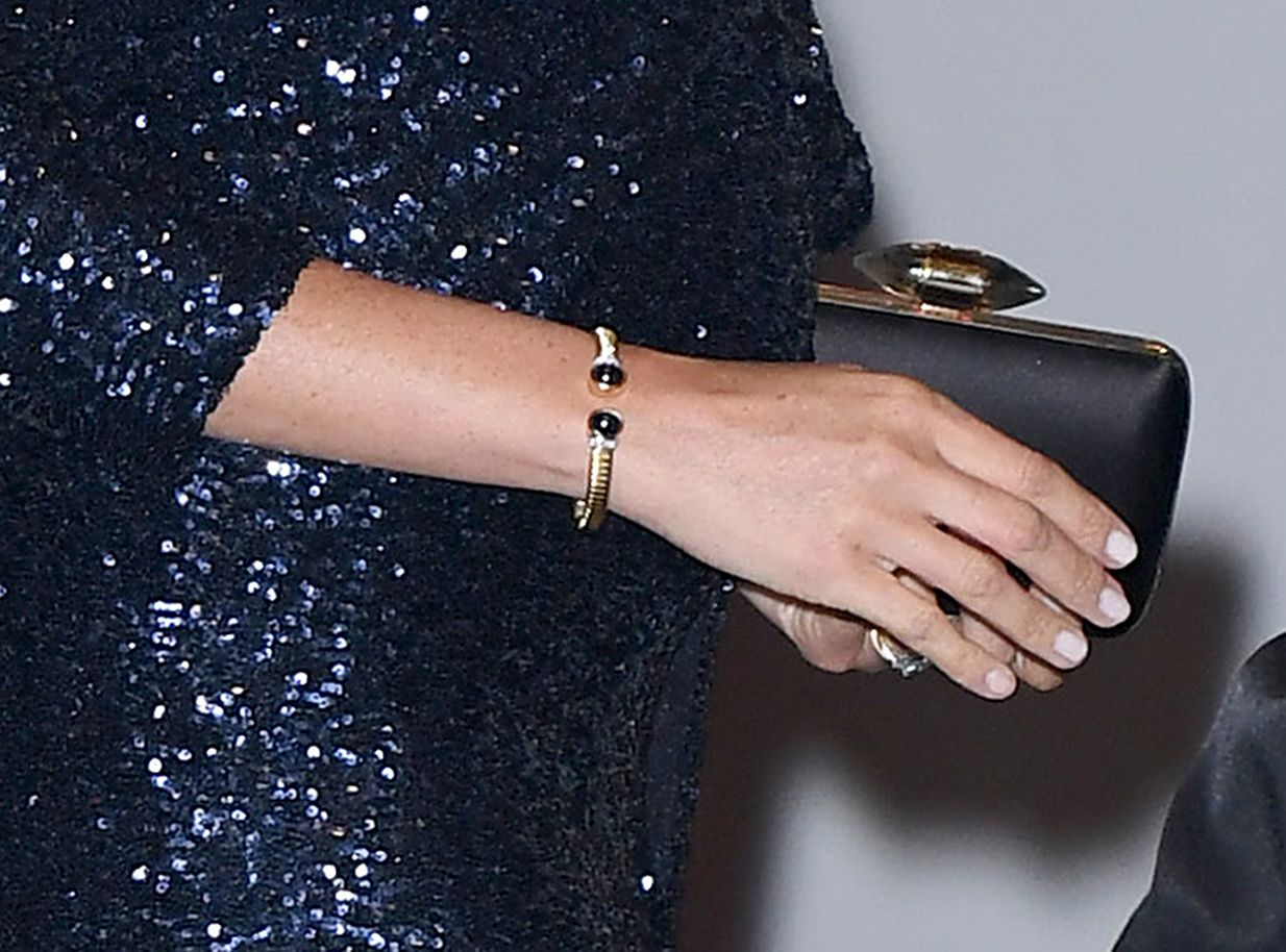 Meghan Wearing the Cuff on January 16, 2019 at Royal Albert Hal The gold bracelet was worn again in January, at one of the first Royal Gala events of 2019, when the Duchess paired it with a gorgeous sequined Roland Mouret gown and Pippa Small Kyanite Stud Earrings.