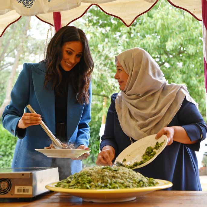 Meghan, Duchess of Sussex prepares food at the launch event for a charity cookbook on September 20, 2018 in London, England.