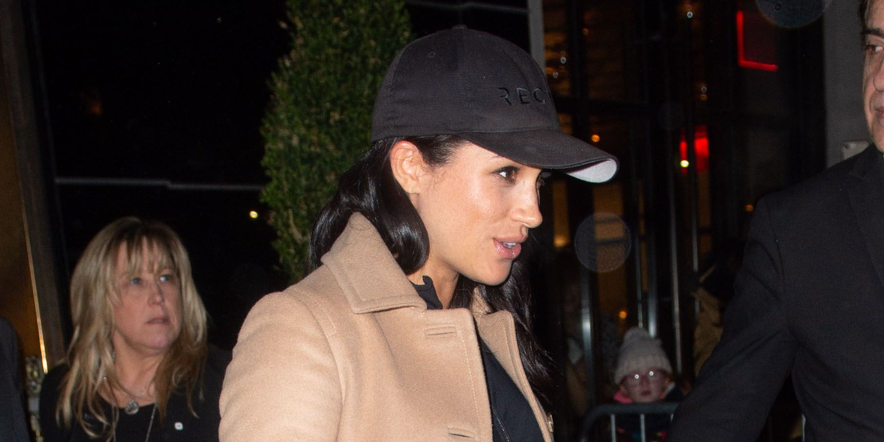 Meghan Markle Heads to the Airport in a Camel-Colored Coat and Casual Black Leggings