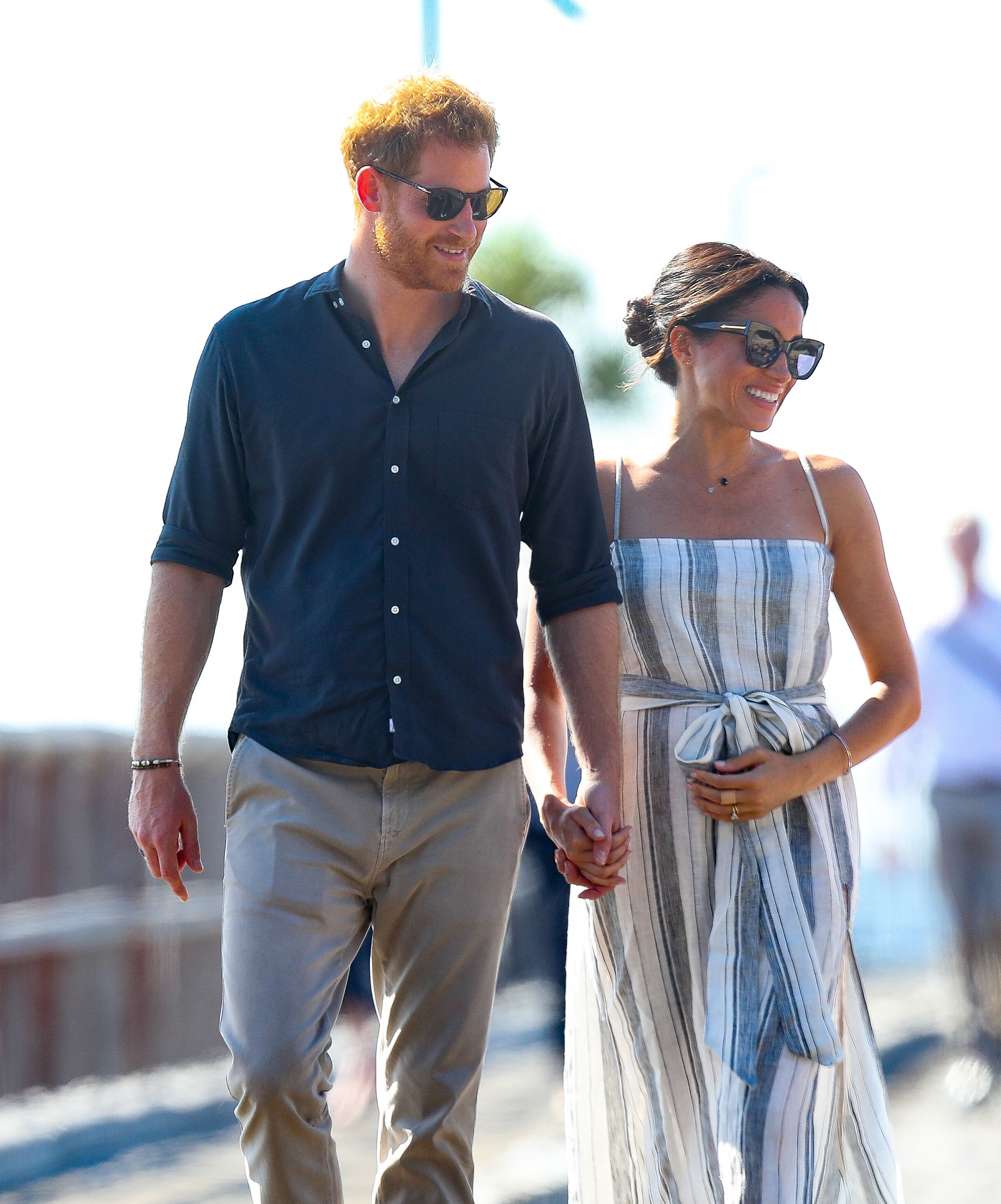 8923ddeed3 Meghan Markle Wears Sundress with Thigh-High Split on Fraser Island for  Prince Harry PDA