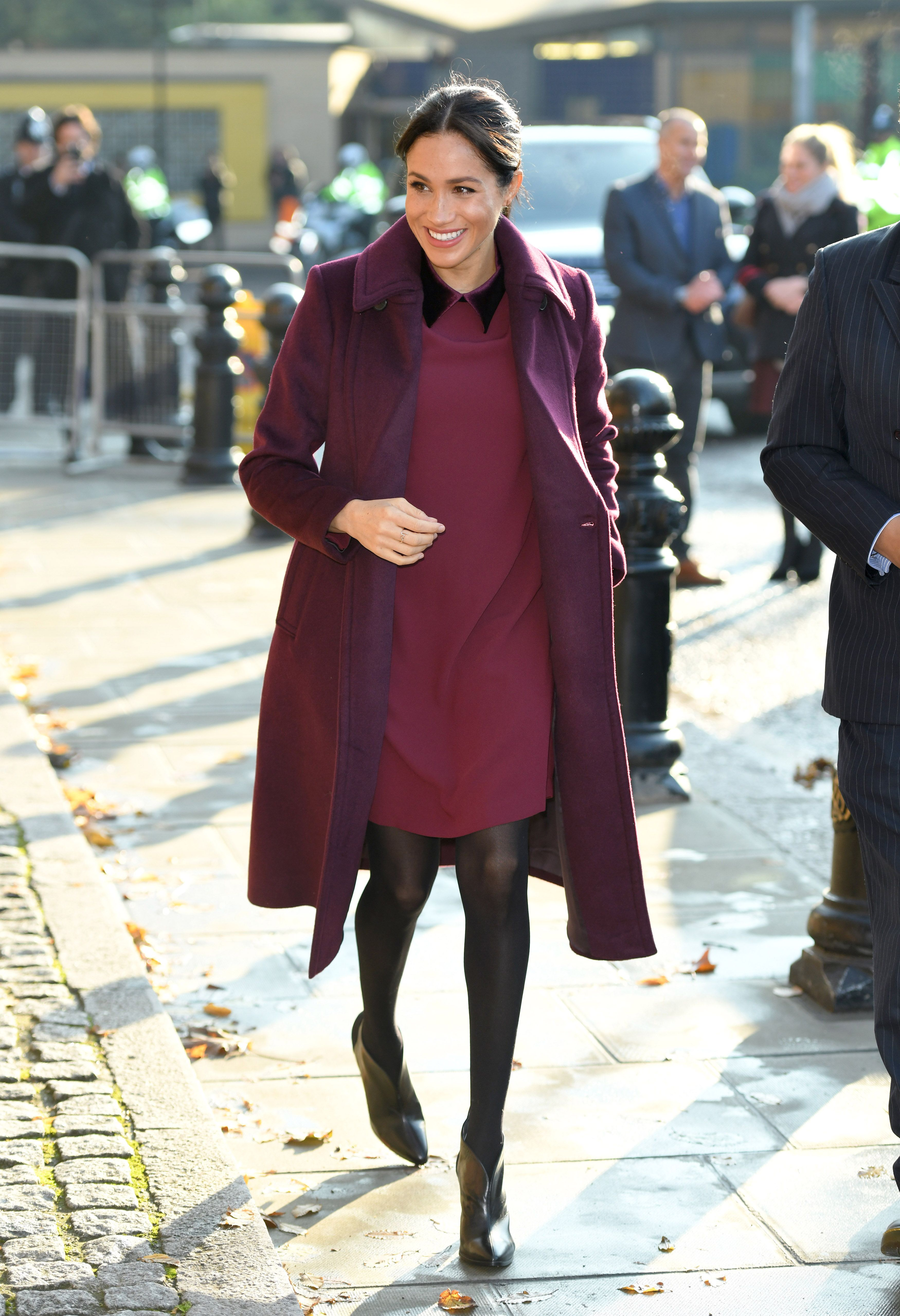 857ea076e6632 Meghan Markle arrives at the Hubb Community Kitchen wearing Club Monaco's  Sallyet dress and Daylina coat. The Duchess' Givenchy ankle boots just so  happen ...