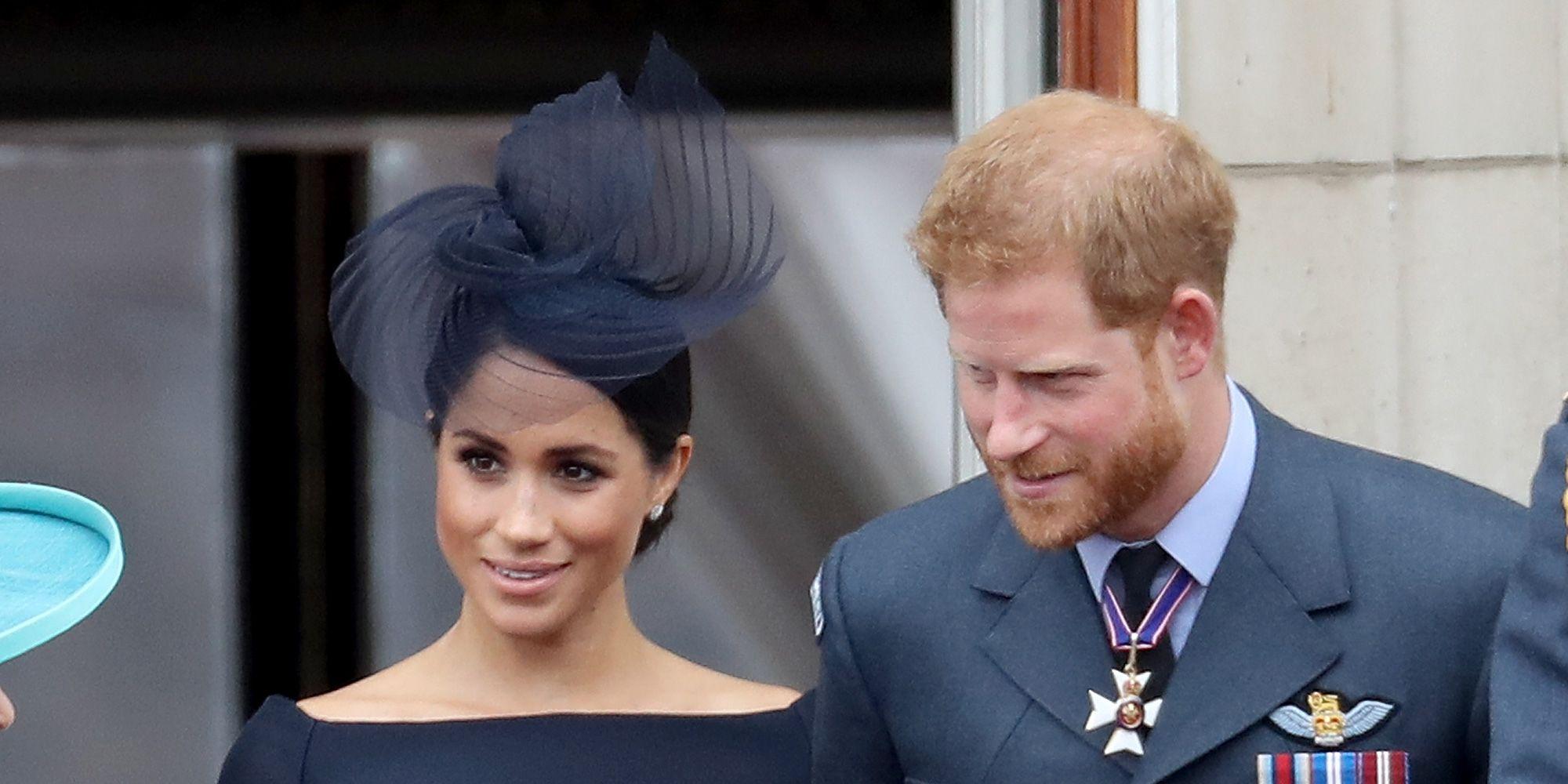 Meghan Markle and Prince Harry shared a sweet PDA moment on Buckingham Palace balcony