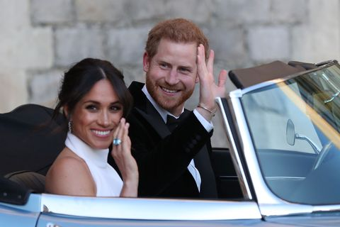 Meghan and Harry driving to wedding reception