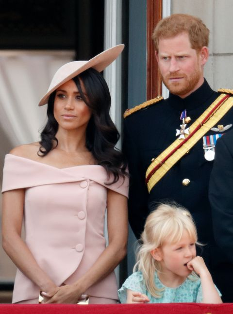 meghan markle with pink two-piece set and hat