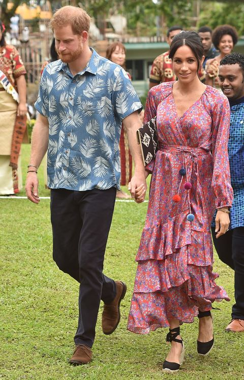 fe4f25ba5e5 Meghan Markle just rocked a colourful pom pom dress and it's our ...