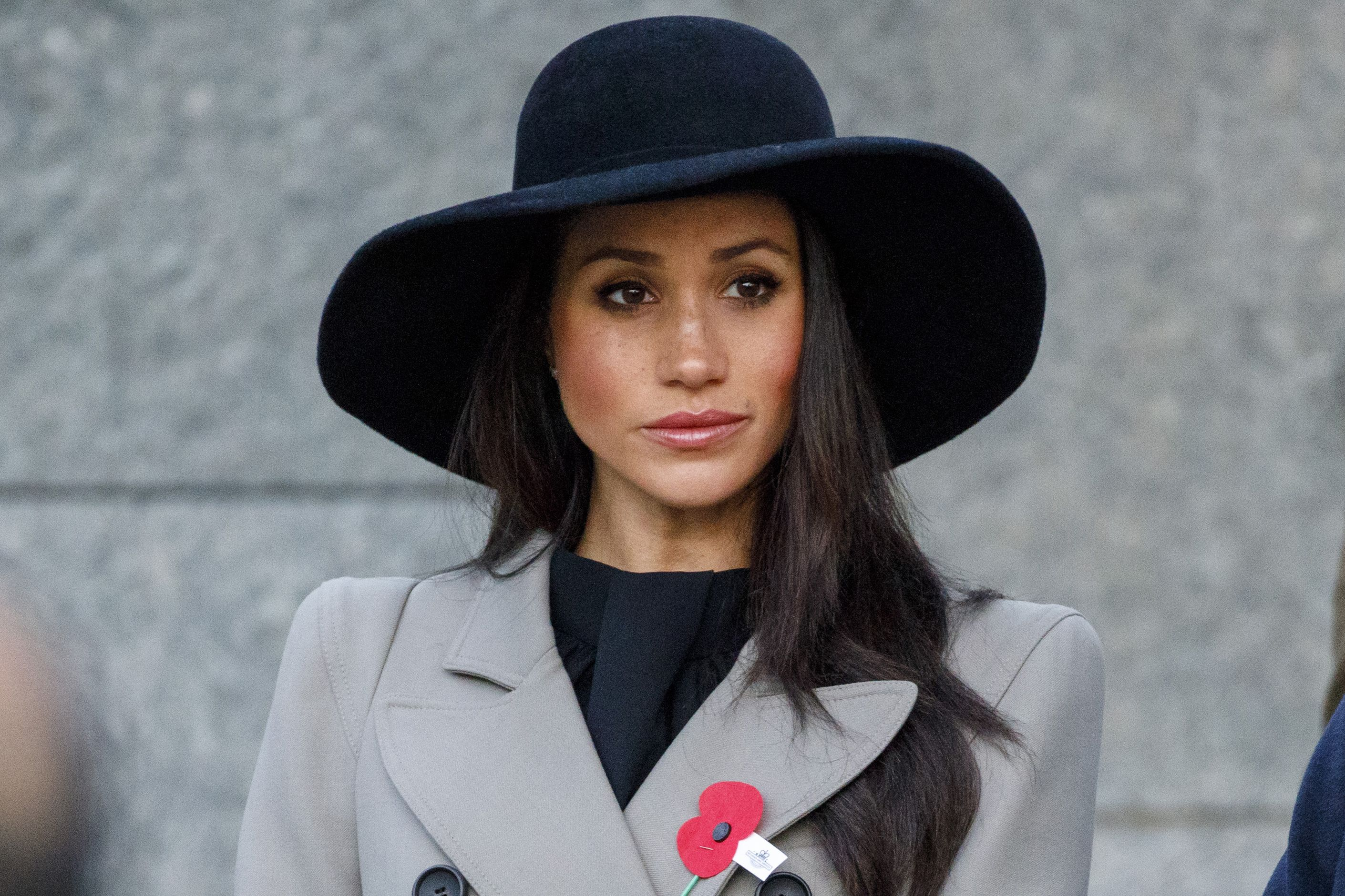 94cac34ef855 Meghan Markle Anzac Day service - Meghan wore a chic black hat and ...