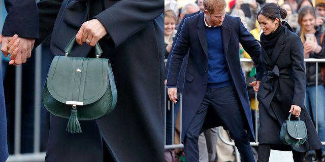meghan markle seen with prince harry carrying a dark green demellier handbag
