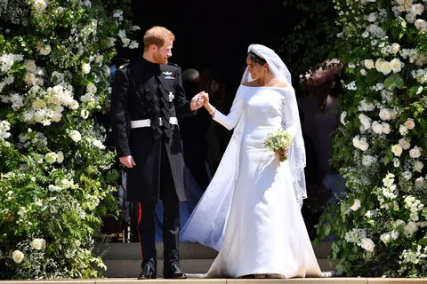 ee9c0b874df2 Meghan Markle wears a Givenchy dress to the royal wedding to Prince Harry.