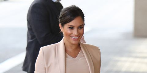 Meghan Markle Visits National Theatre In London In A Blush Dress And