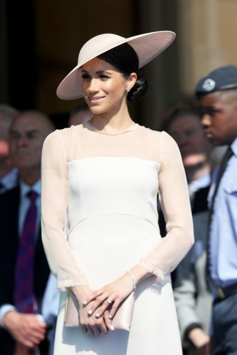 56a560923c Meghan Markle covers her shoulders as she joins the Queen on royal ...