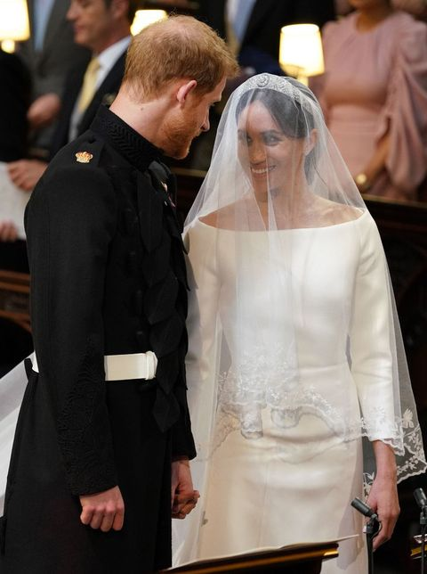 d29ee9709b769 Meghan Markle and Prince Harry holding hands during the royal wedding  ceremony.