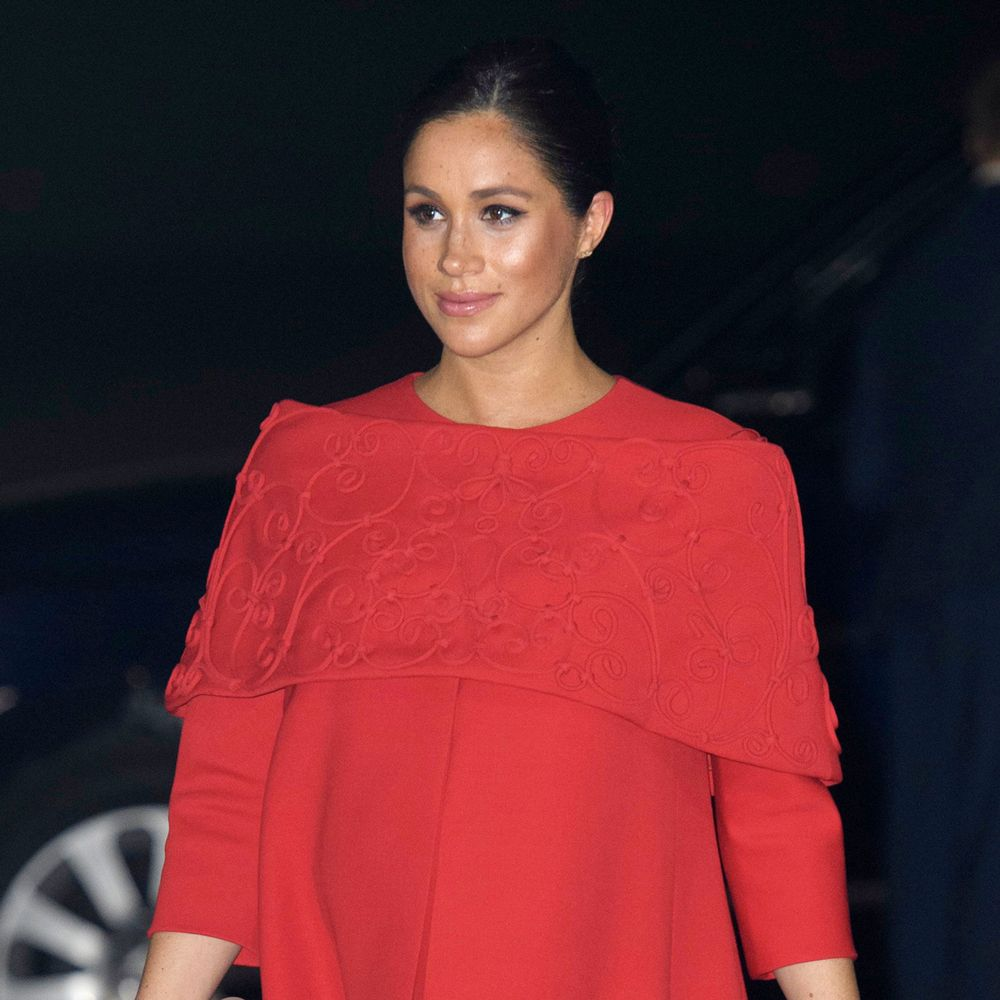 Meghan Markle looks a vision in red as she starts her Moroccan royal tour with Prince Harry