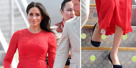7ff7add97bb9 Meghan Markle accidentally left the tag on her dress and we ve all ...