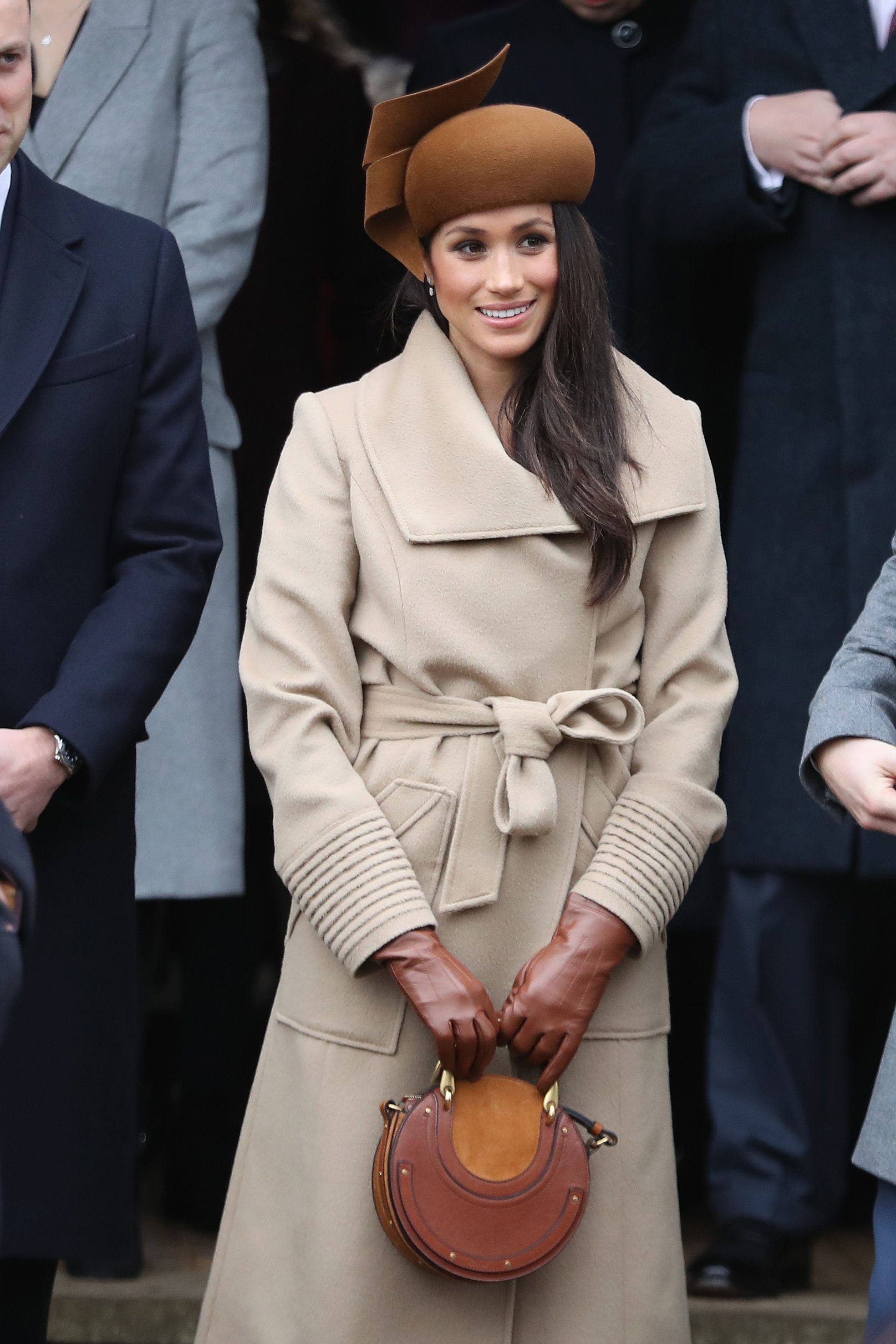 Image result for meghan markle duchess holding clutch
