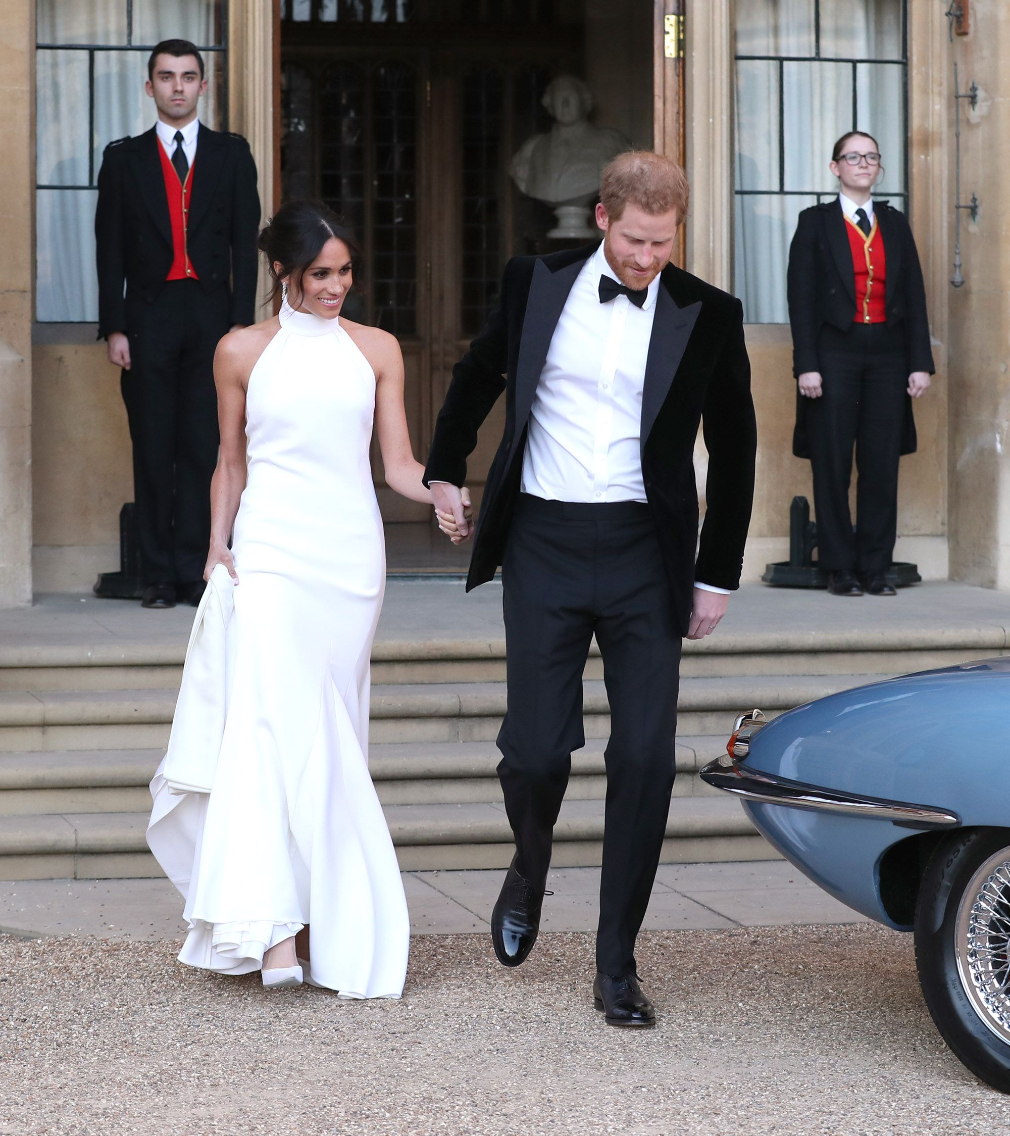 Meghan Markle wears a white Stella McCartney dress to her wedding reception.