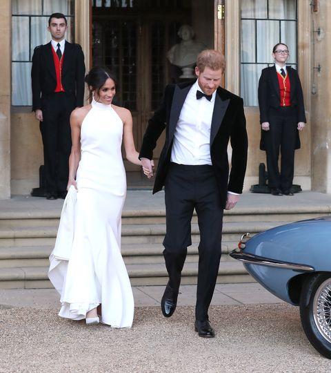 Meghan Markle wears a white Stella McCartney dress to her wedding reception.