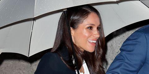 Meghan Markle wearing a black suit