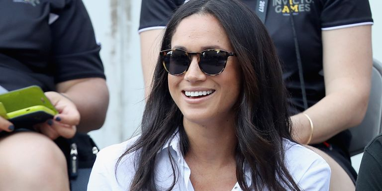 Meghan Markle Looks Chic in a White Shirt and Black Capri Pants at the Polo with Prince Harry