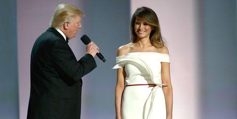 Microphone, Audio equipment, Human body, Joint, Standing, Formal wear, Coat, Suit, Dress, Waist,