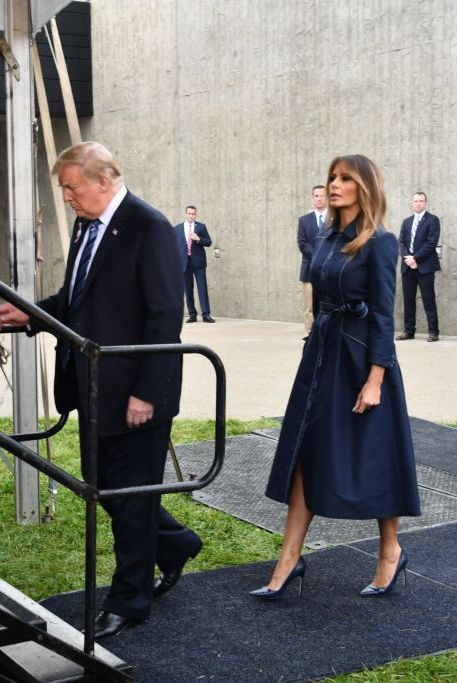 20f2b16ebc4 image. Getty Images. Melania Trump wore a dark blue belted dress ...