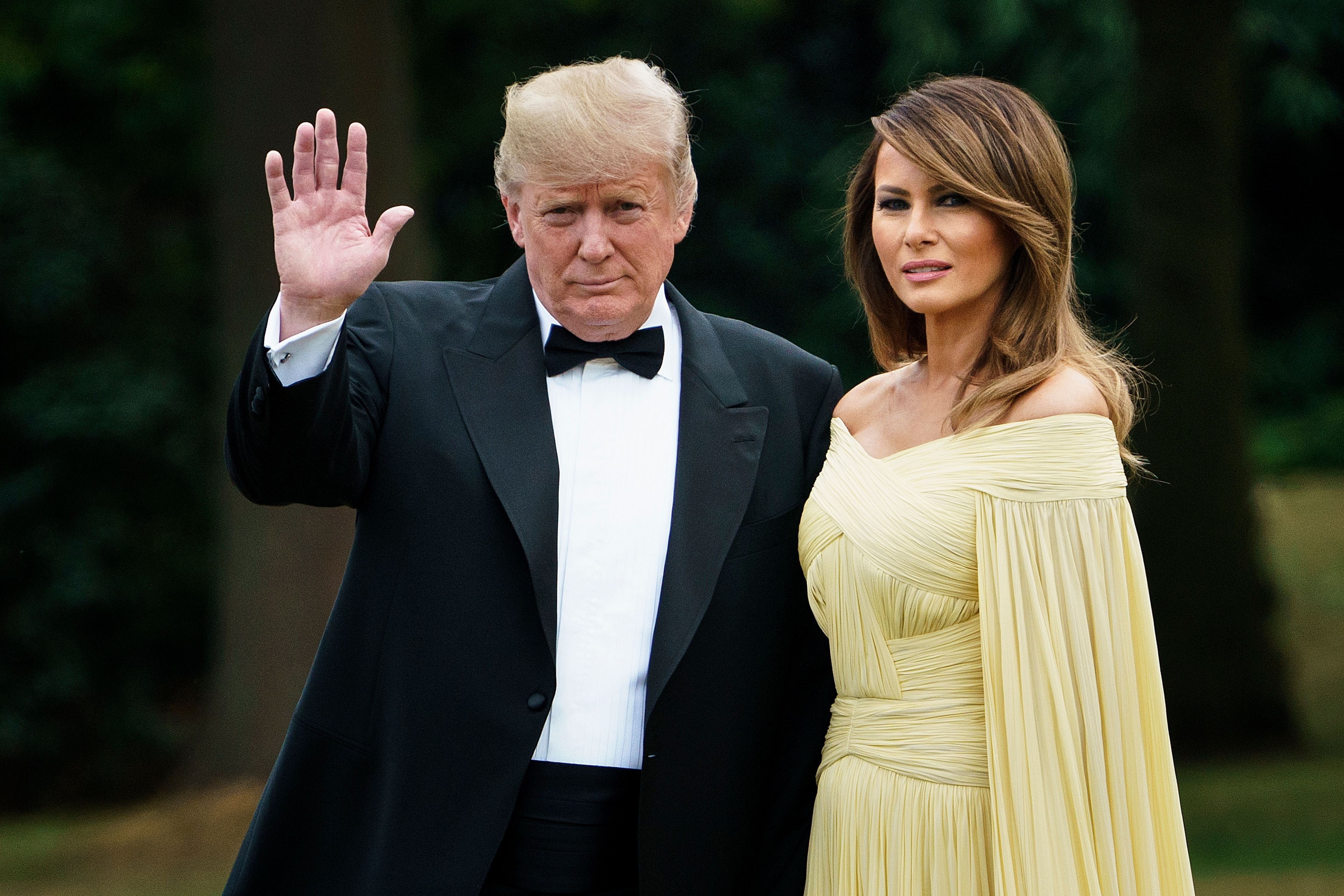 Melania Trump S Yellow Caped Gown Draws Comparisons To A Disney Princess