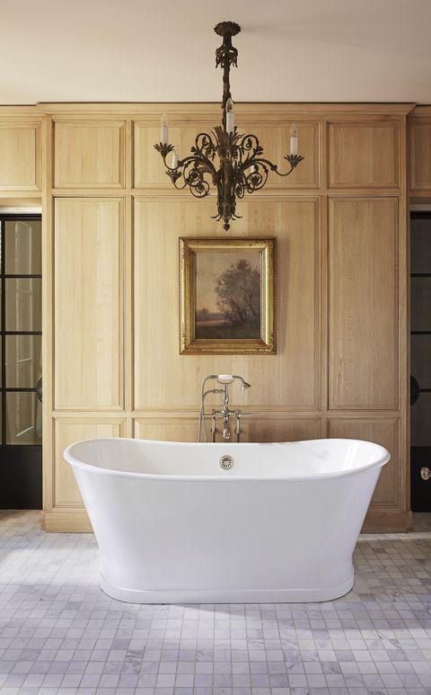 handsome oak paneling and a deep soaking tub headline the owners bath